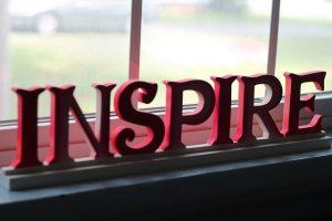 red letters spelling inspire for inspirational leadership